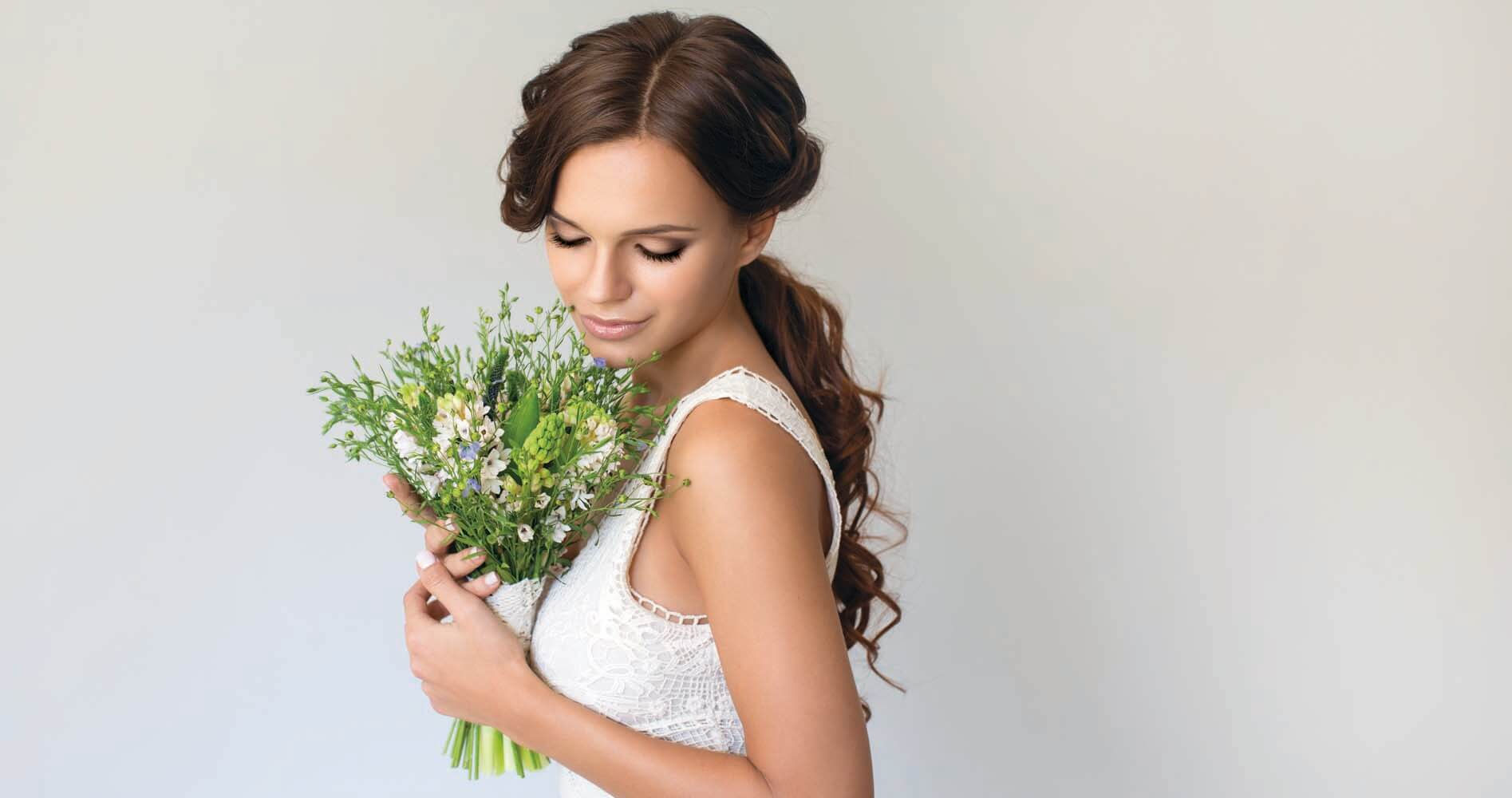 Studio shot of young beautiful bride. Professional make up and hair style.